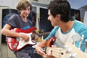 Photo of boys playing guitar