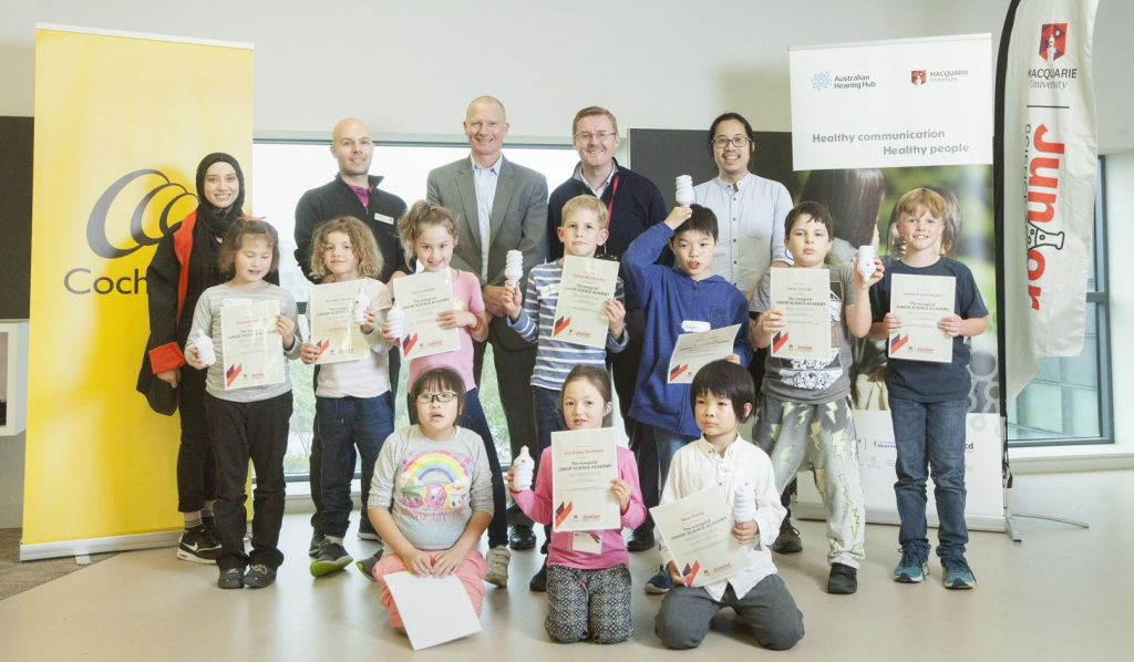 Children receiving certificate at the science camp