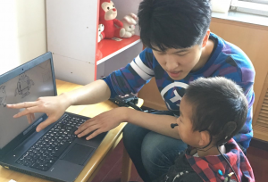 Researcher working with a child with Cochlear Implants